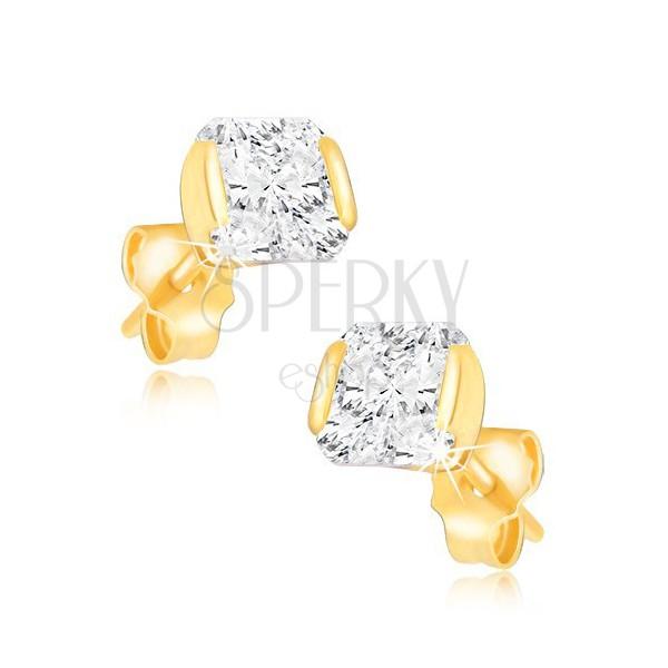 Goldene Ohrstecker - glänzender Zirkon in einer Hülse befestigt