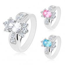 Ring mit breiter Ringschiene, farbiges großes Oval, runde klare Zirkoniasteine
