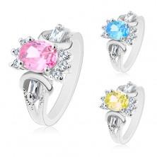 Silberfarbener Ring, farbiger ovaler Zirkonia, runde und eckige Schmucksteine