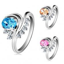 Silberfarbener Ring, gebogene Linien, bunter ovaler Zirkon und klare Schmucksteine