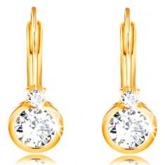 14K Gelbgold Ohrringe – größerer runder Zirkon in einer Fassung und ein kleiner Zirkon