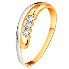 Brillantring in 18K Gold, gewellte zweifarbige Ringschiene, drei klare Diamanten