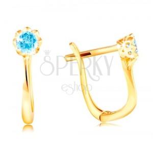 Ohrringe aus 585 Gelbgold - glitzernder blauer Zirkon in einer dekorativen Fassung