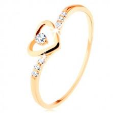 Ring aus 375 Gold, Herzkontur mit klarem Zirkon, geschmückte Arme