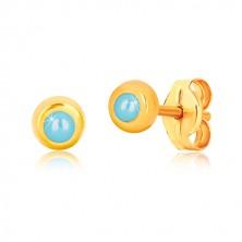 Ohrringe aus 9K Gelbgold - glänzende runde Fassung mit einem synthetischen Türkis