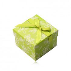 Papier Geschenkschachtel in einem hellgrünen Farbton, grünes Band mit einer Schleife, Blumen